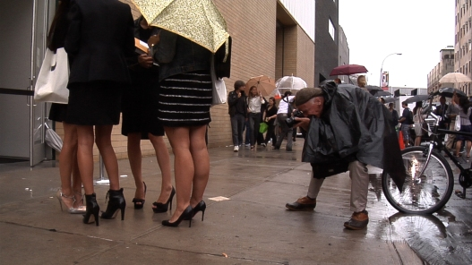 """Bill Cunningham shooting women attending a fashion show in Chelsea during Fashion Week in New York City from the feature-length documentary, """"Bill Cunningham New York,"""" ( 2010), directed by Richard Press and produced by Philip Gefter. credit: First Thought Films Contact Philip Gefter: philipgefter@gmail.com"""