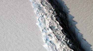 View of a massive rift in the Antarctic Peninsula's Larsen C ice shelf. 2016. Image courtesy NASA/John Sonntag